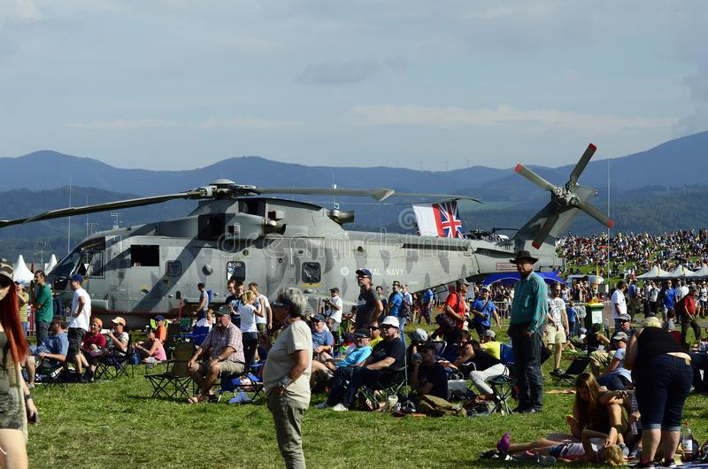 Airshow, Airpower 16,. Zeltweg, Styria, Austria - September 02, 2016: Crowd of spectators and Augusta-Westland helicopter AW 101 aka Merlin by public airshow stock photo
