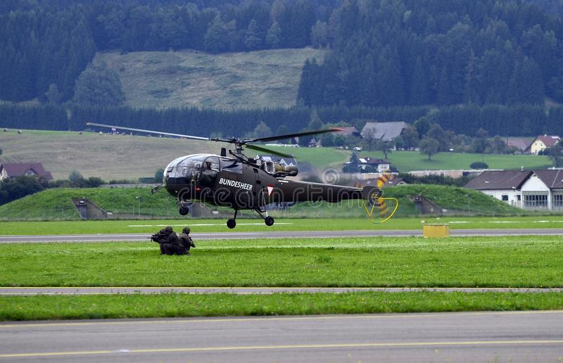 Airshow, Airpower 16,. Zeltweg, Styria, Austria - September 02, 2016: Field exercise with Alouette helicopter by public airshow named airpower 16 stock image