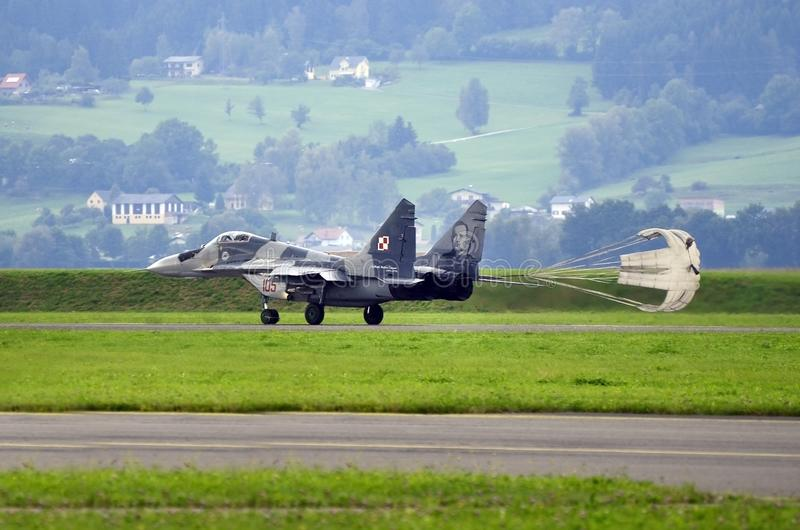Airshow, Airpower 16,. Zeltweg, Styria, Austria - September 02, 2016: MiG 29 Fulcrum with landing parachute by public airshow named airpower 16 royalty free stock images