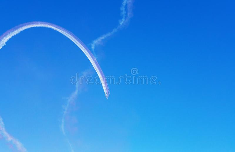 Airshow in Doha, Qatar. Aerobatic team performs flight at air show. Airshow in Doha, Qatar. Airplanes on airshow. Aerobatic team performs flight at air show stock images