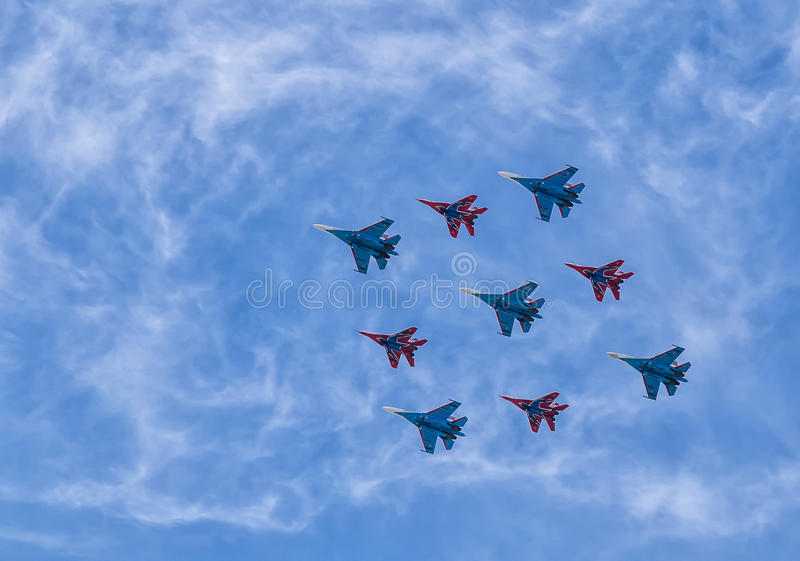 Airshow. Group pilotage of the russian aerobatic teams at the airshow during the Victory Day parade. Moscow, Russian Federation - May 9, 2015 stock photos
