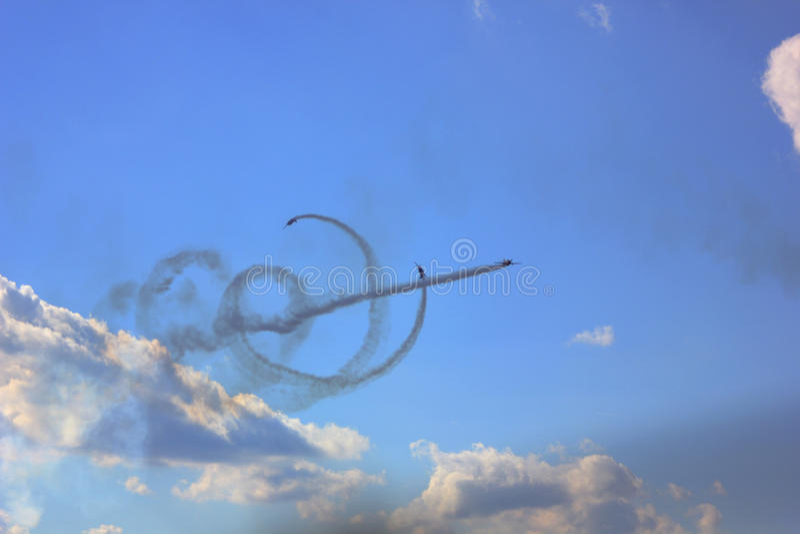 Airshow. Planes perform aerobatics barrel in the sky blue stock photo
