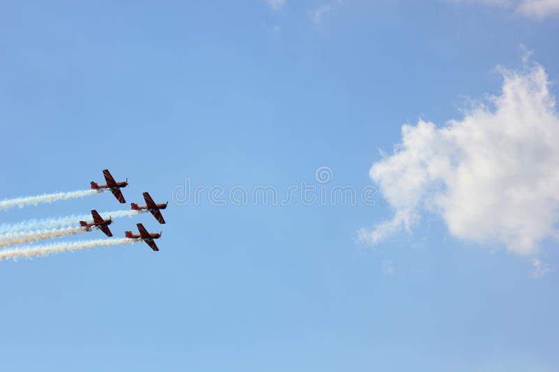 Airshow. Planes perform aerobatics barrel in the sky blue stock photography