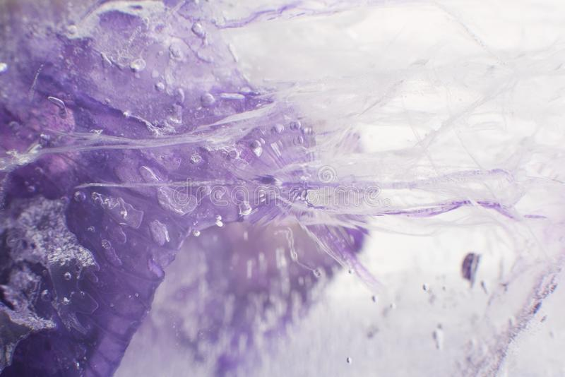 Airy delicate bubbles flowing through ice with purple colors underneath 2. Airy delicate bubbles flowing through ice with purple colors underneath. Ideal for stock photos