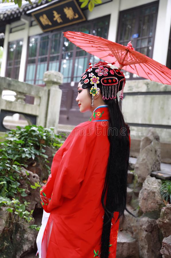 Aisa Chinese actress Peking Beijing Opera Costumes Pavilion garden China traditional drama play dress perform ancient parasol royalty free stock photo