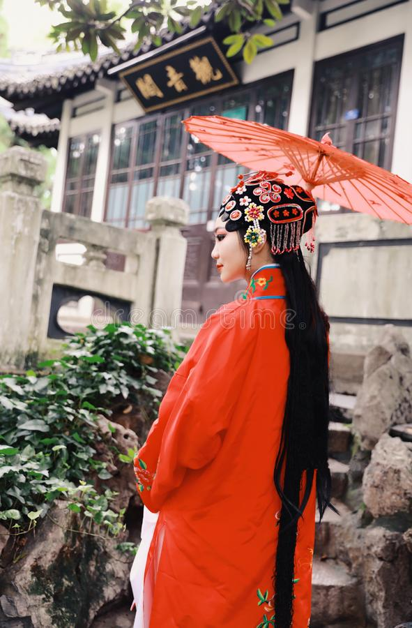 Aisa Chinese actress Peking Beijing Opera Costumes Pavilion garden China traditional drama play dress perform ancient parasol royalty free stock photos