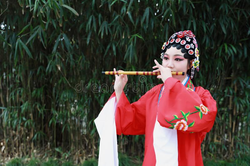 Aisa Chinese woman Peking Beijing Opera Costumes dress garden China traditional drama perform ancient Bamboo flute instruments royalty free stock photography
