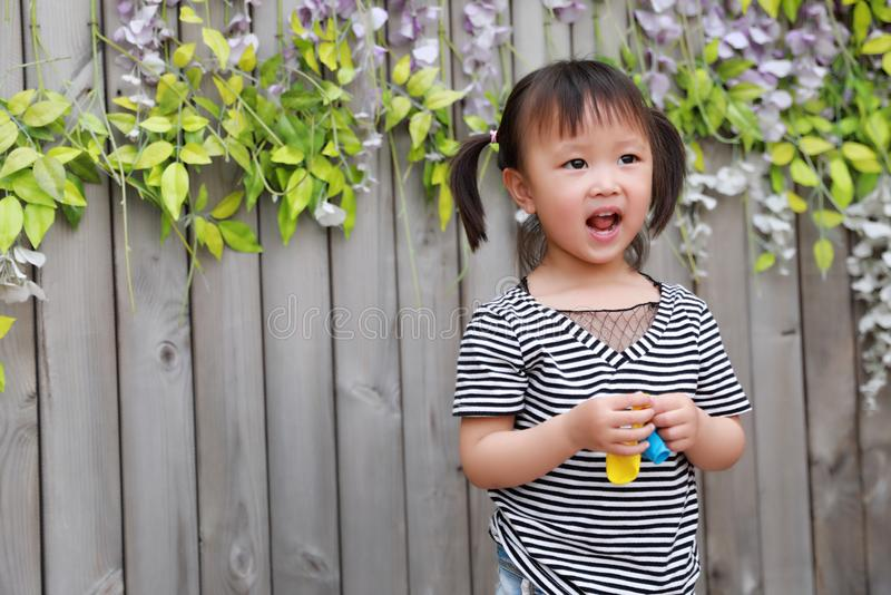 Aisa cute naughty lovely adorable child girl play with balloon have fun outdoor in summer park happy smile happiness childhood royalty free stock photography