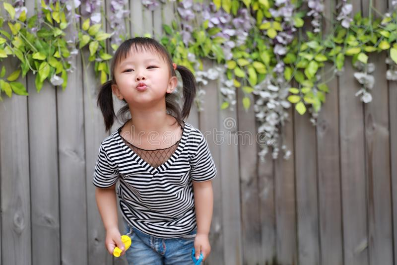 Aisa cute naughty lovely adorable child girl play with balloon have fun outdoor in summer park happy smile happiness childhood stock images
