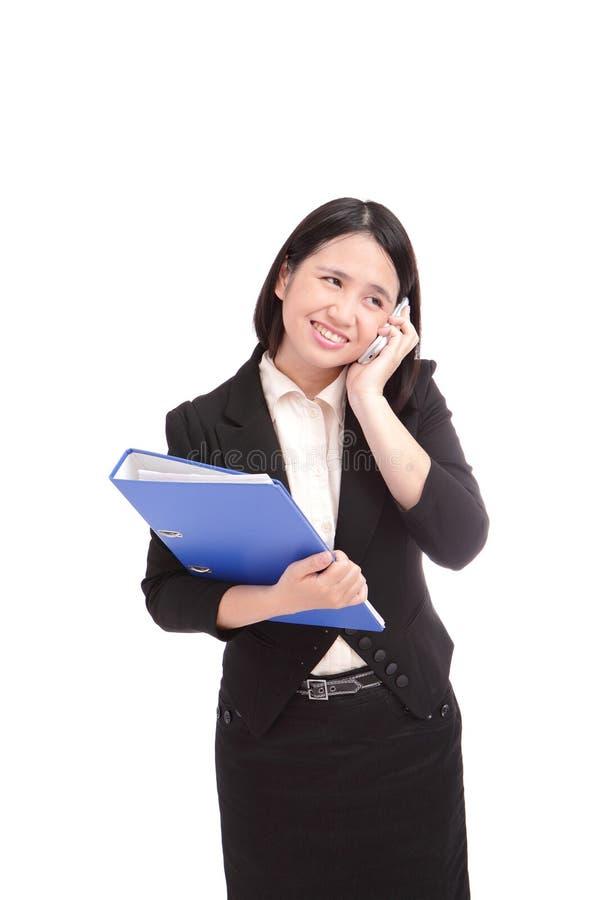 aisan企业移动电话告诉的妇女 库存图片