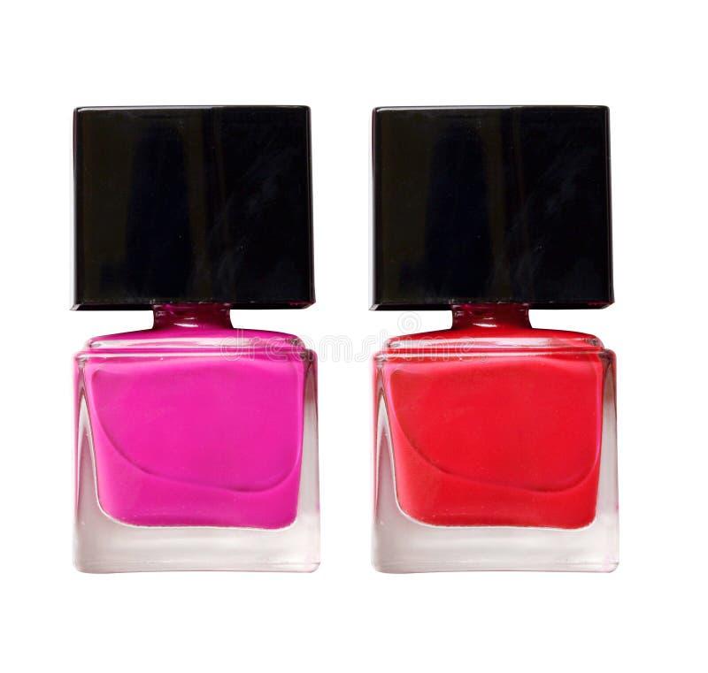 Aislante rojo y rosado de la botella del esmalte de uñas en blanco imágenes de archivo libres de regalías