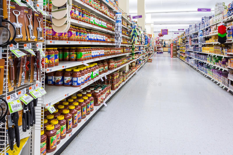 Aisle in an American supermarket. Condiments and spices aisle in an American supermarket royalty free stock images