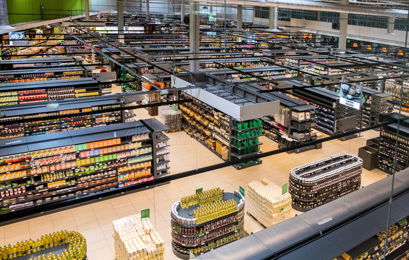 Aisle view of grocery store Norfa Hypermarket. Vilnius, Lithuania - June 11, 2017: Aisle view of grocery store Norfa Hypermarket. Established in 1997, Norfa is royalty free stock photography