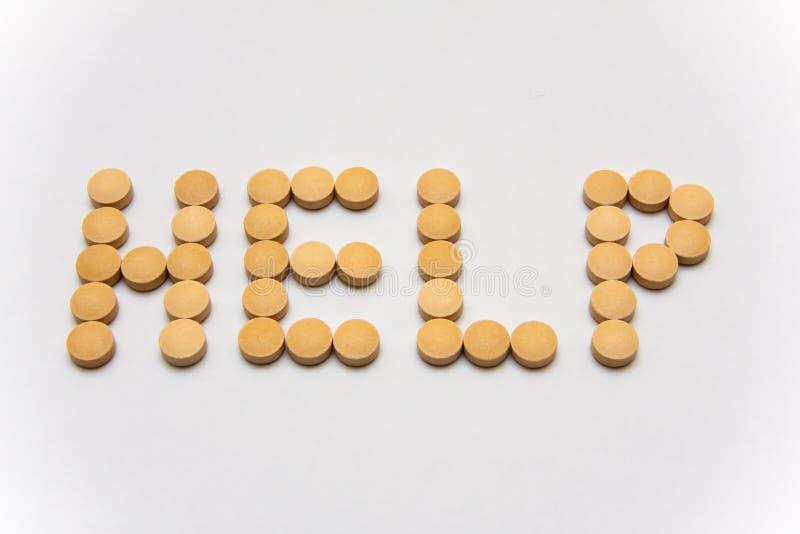 Aiuto di parola di periodo con le pillole immagini stock libere da diritti