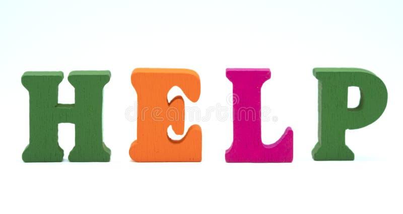 Aiuto inglese di parola delle lettere di legno variopinte immagini stock libere da diritti