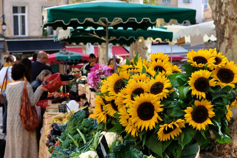 Aix-en-Provence, France - October 18, 2017 : people buying vegetables and flowers in the central provence market stock photography
