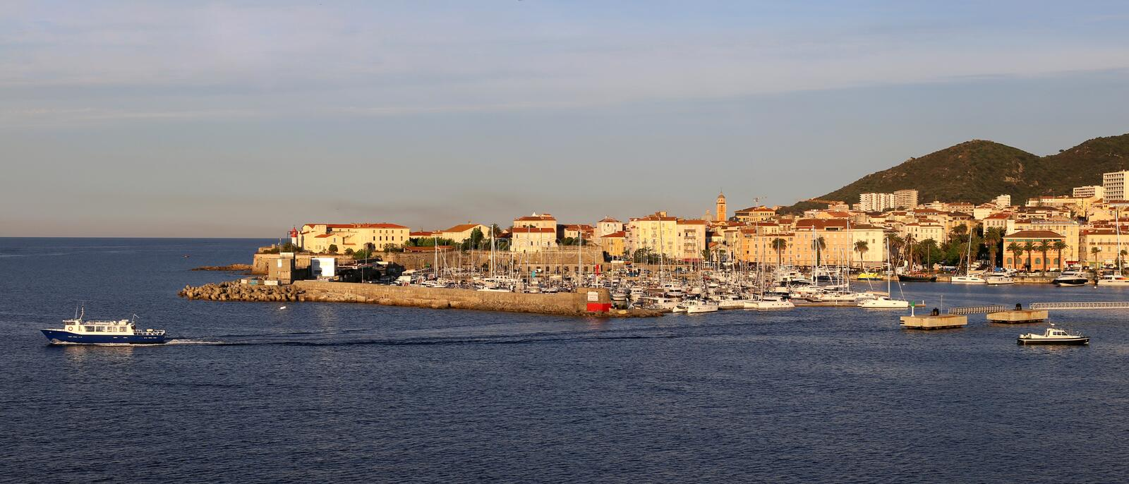 Ajaccio, Corsica. Harbour and city Ajaccio with citadel on Corsica, isle in the Mediterranean royalty free stock images