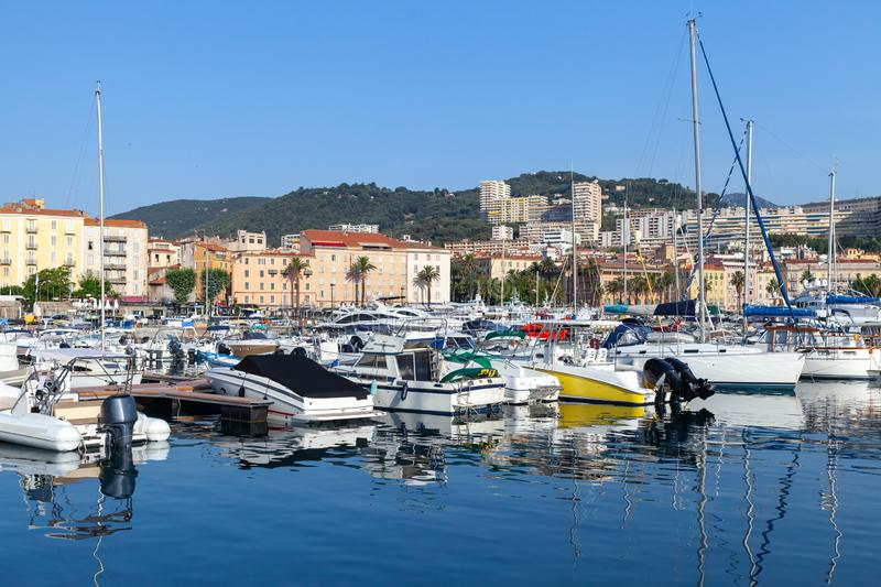 Ajaccio port. Coastal cityscape, Corsica. Ajaccio port. Coastal cityscape with sailing yachts and pleasure motor boats moored in marina, Corsica island, France stock photos