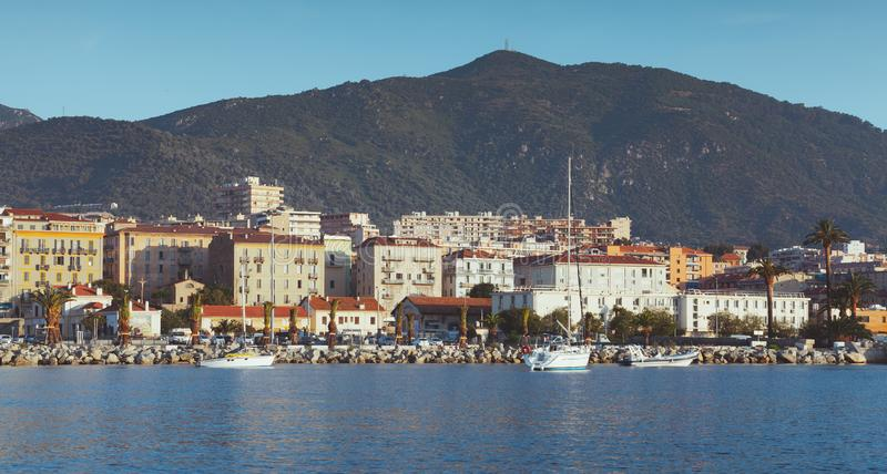 Ajaccio port, seaside view. Corsica. Port of Ajaccio, seaside view. Corsica, French island in the Mediterranean Sea. Summer cityscape with vintage tonal stock photography