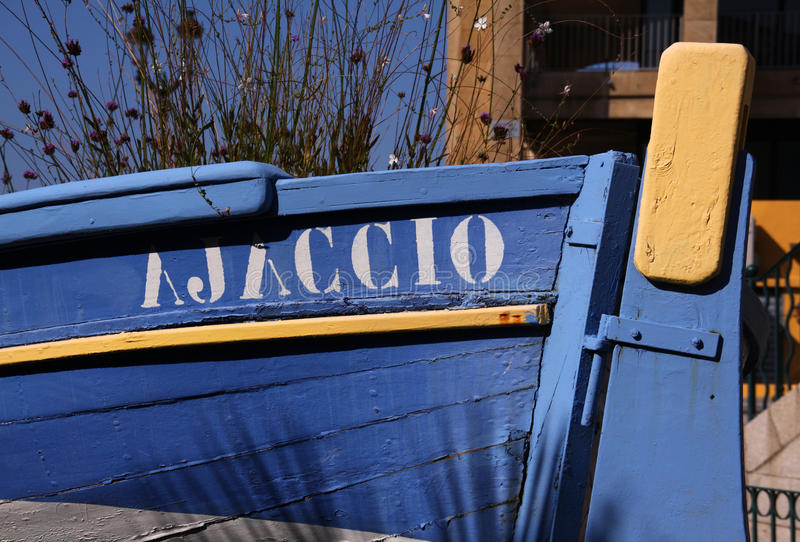 Ajaccio traditional boat decorating park. France Corsica Ajaccio traditional blue wooden fishing boat - now decorating a local park royalty free stock image