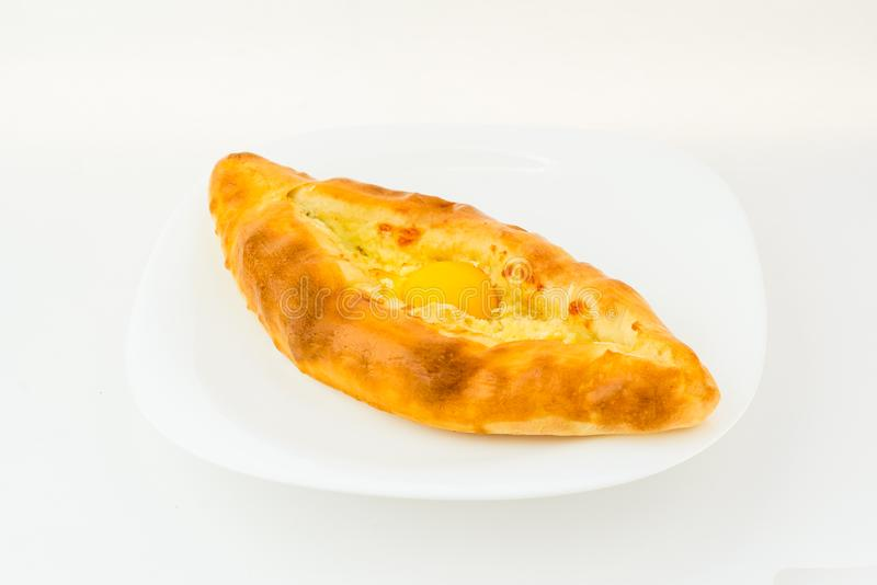 Ajarian khachapuri in plate isolated on white stock photography