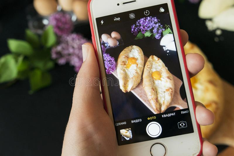 Adjara khachapuri with two types of cheese. Ajarian khachapuri with two types of cheese. Delicious pastries. The photo with the hands royalty free stock photos