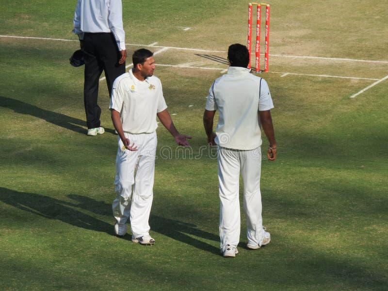 Ajit Agarkar e Zahir Khan fotografia de stock