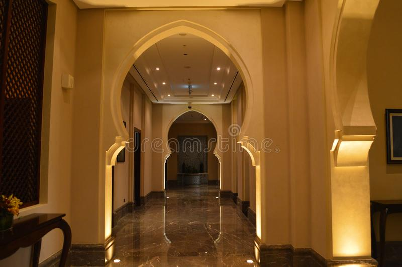 Ajman. June 2019. Beach hotel Ajman Saray. Corridor inside the hotel, with arches in the Arabic, Oriental style. royalty free stock photos