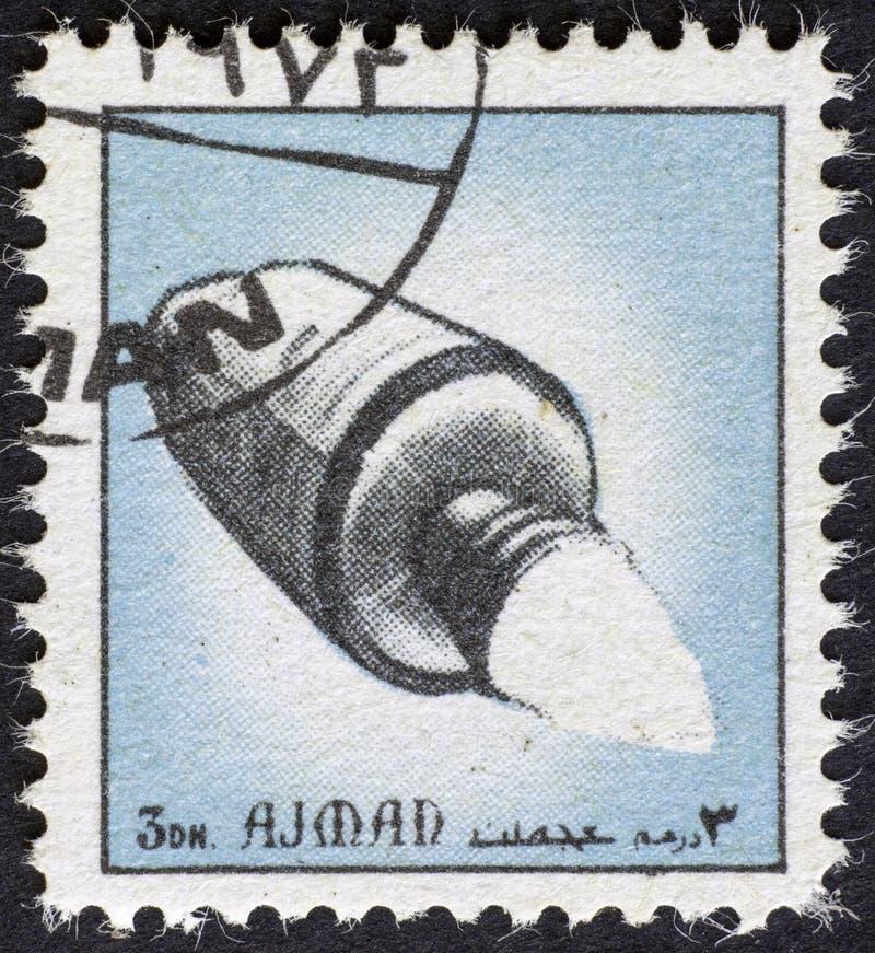 AJMAN/MANAMA - CERCA DE 1972: O selo postal imprimiu por Ajman sobre a história do espaço, imagens de stock