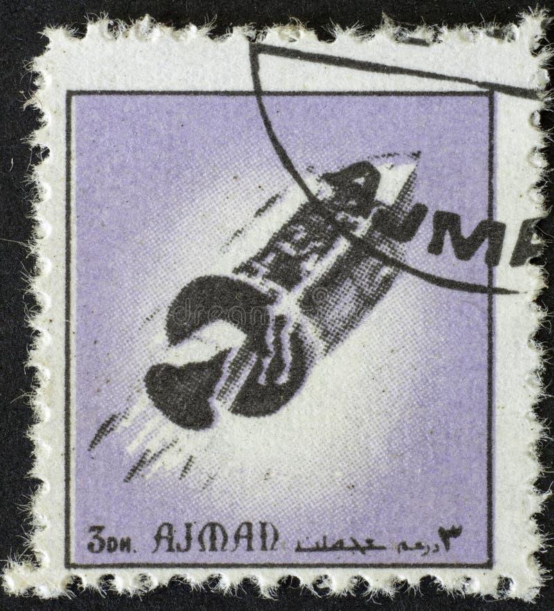 AJMAN/MANAMA - CIRCA 1972: Il francobollo ha stampato da Ajman circa la storia di spazio, immagine stock