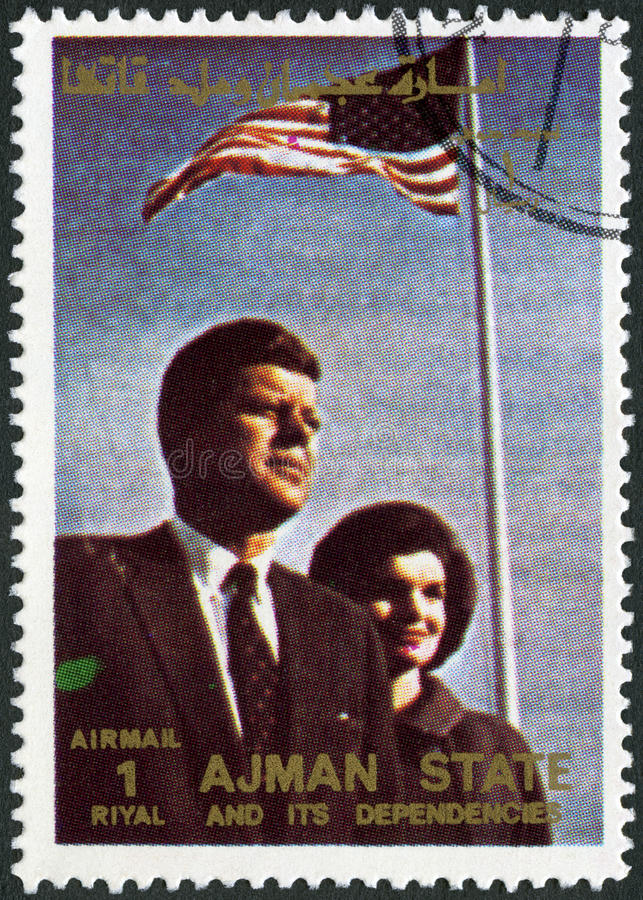 AJMAN - 1972: shows John F. Kennedy (1917-1963) and wife Jacqueline Lee Jackie Bouvier (1929-1994). AJMAN - CIRCA 1972: A stamp printed in Ajman shows John F stock images