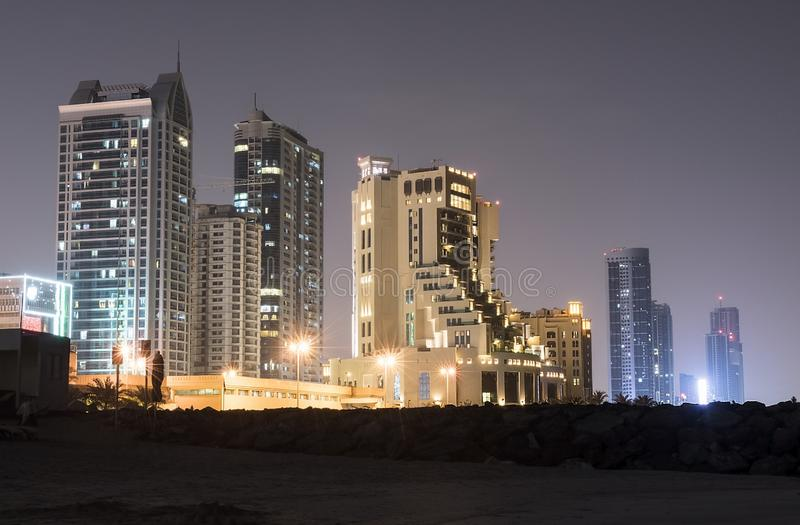 Several multi-story illuminated days on the shores of the Persian Gulf royalty free stock photo