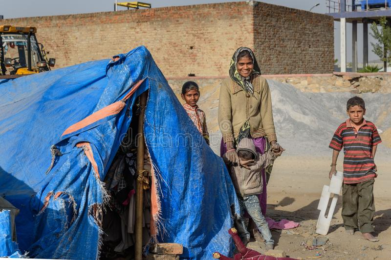 Poor people come with family to the city from the village for work. And they living in the street in tent home. Ajmer. Rajasthan. Ajmer, India - February 07 royalty free stock photography