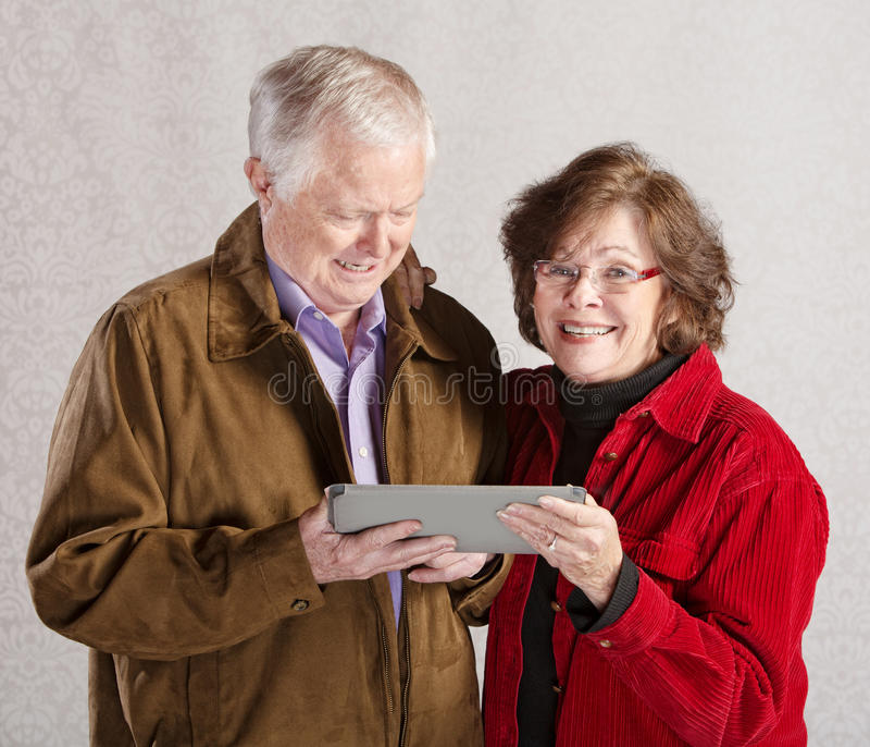 Ajouter heureux à la Tablette images stock