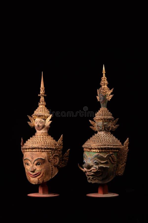 Ajouter thaïlandais géants de masque au fond noir photographie stock libre de droits