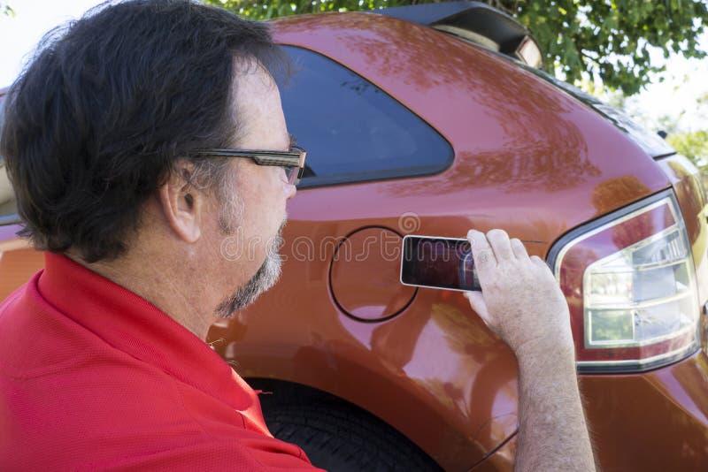 Ajustador de Insuarance que toma fotos fotografia de stock royalty free