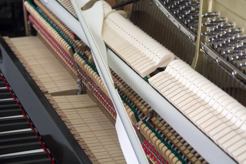 Ajustando seu piano imagens de stock