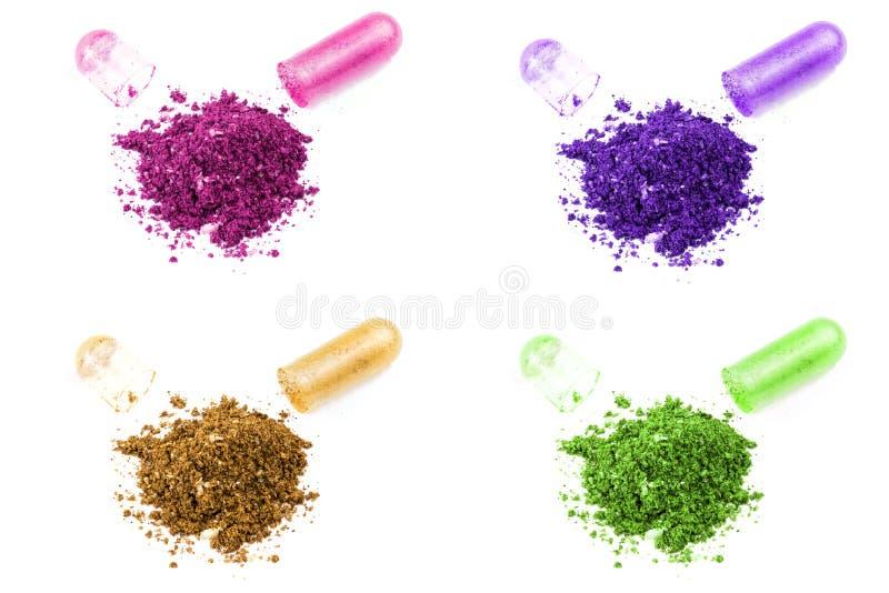 Ajuste da cápsula orgânica colorida aberta do MED isolada no close up branco do fundo fotografia de stock royalty free