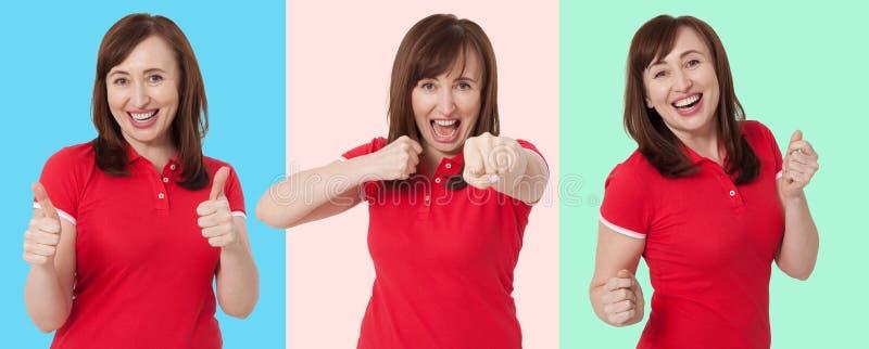 Ajuste da cara entusiasmado chocada surpreendida da mulher isolada no fundo colorido Idade Média fêmea na camisa do verão t Copie imagens de stock