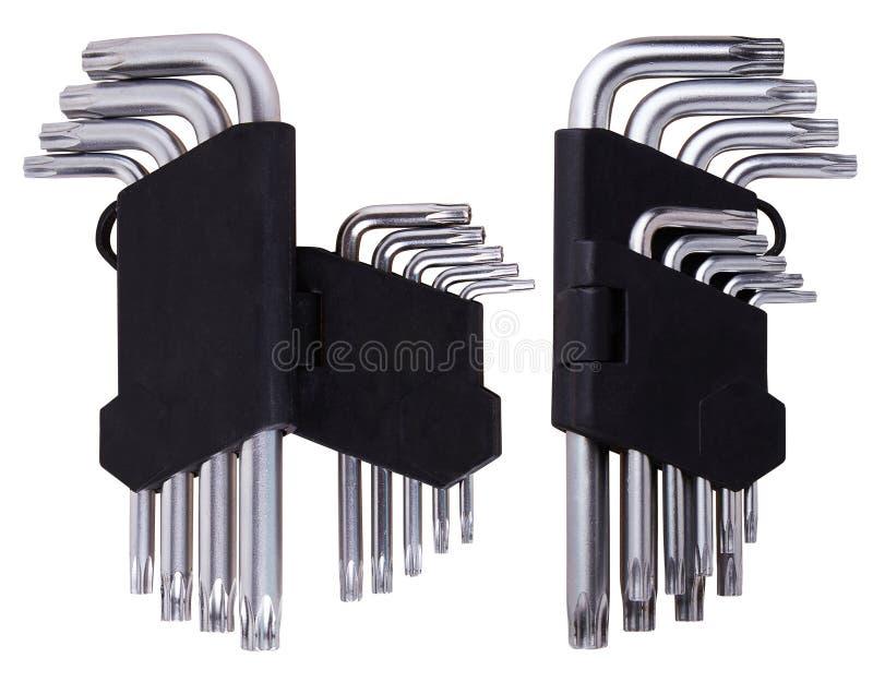 Ajuste das chaves de Allen das chaves Hex no suporte plástico preto em um fundo branco foto de stock