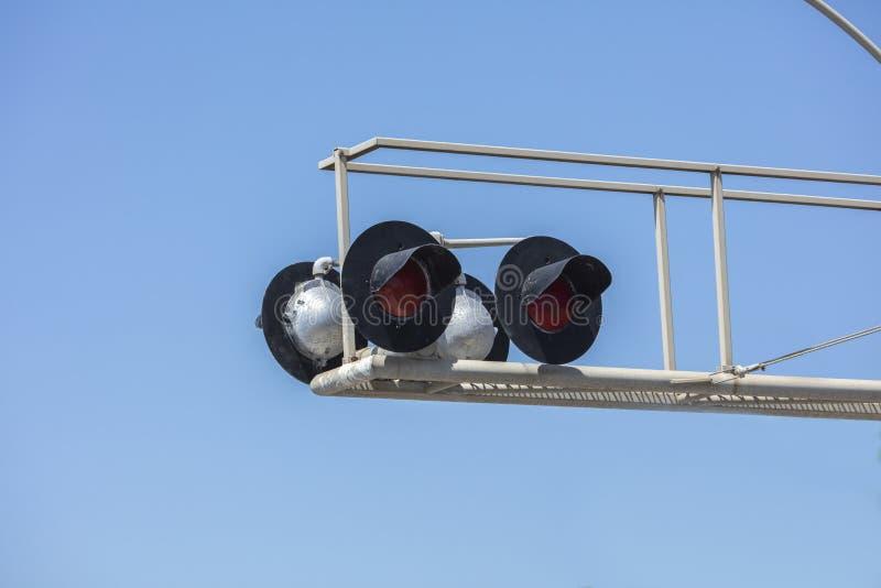 Ajuste de quatro luzes e rampas do cruzamento de estrada de ferro fotografia de stock royalty free