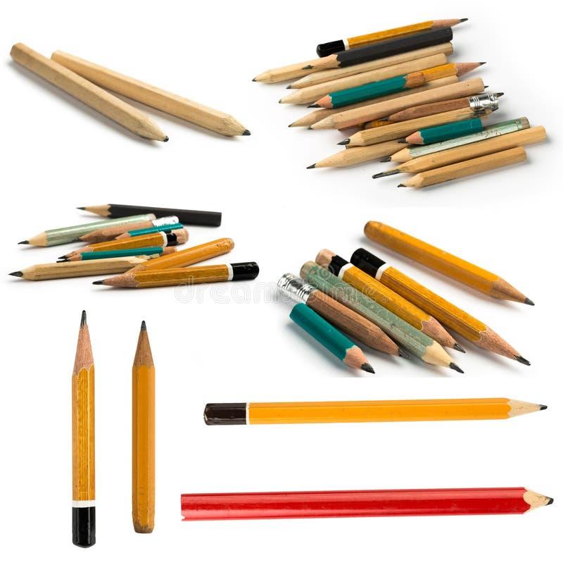 Ajuste dos lápis curtos no fundo isolado imagem de stock royalty free
