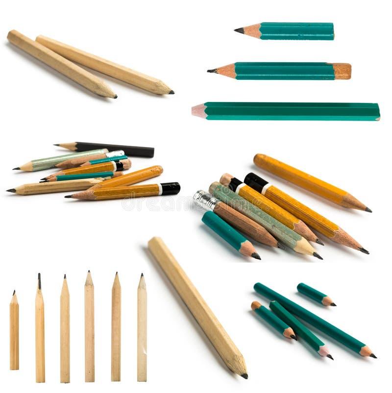 Ajuste dos lápis curtos no fundo isolado fotos de stock royalty free