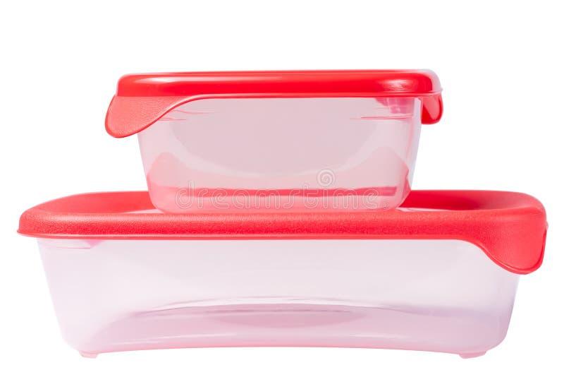 Ajuste dos recipientes pl?sticos com a tampa vermelha isolada no fundo branco fotografia de stock