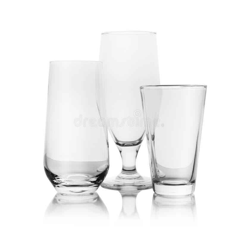Ajuste dos vidros vazios para bebidas diferentes no branco imagens de stock royalty free