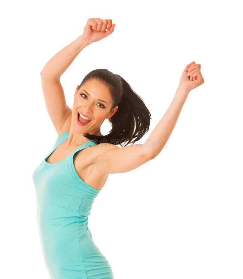 Ajuste feliz e dança magro e salto da mulher isolados sobre o branco foto de stock