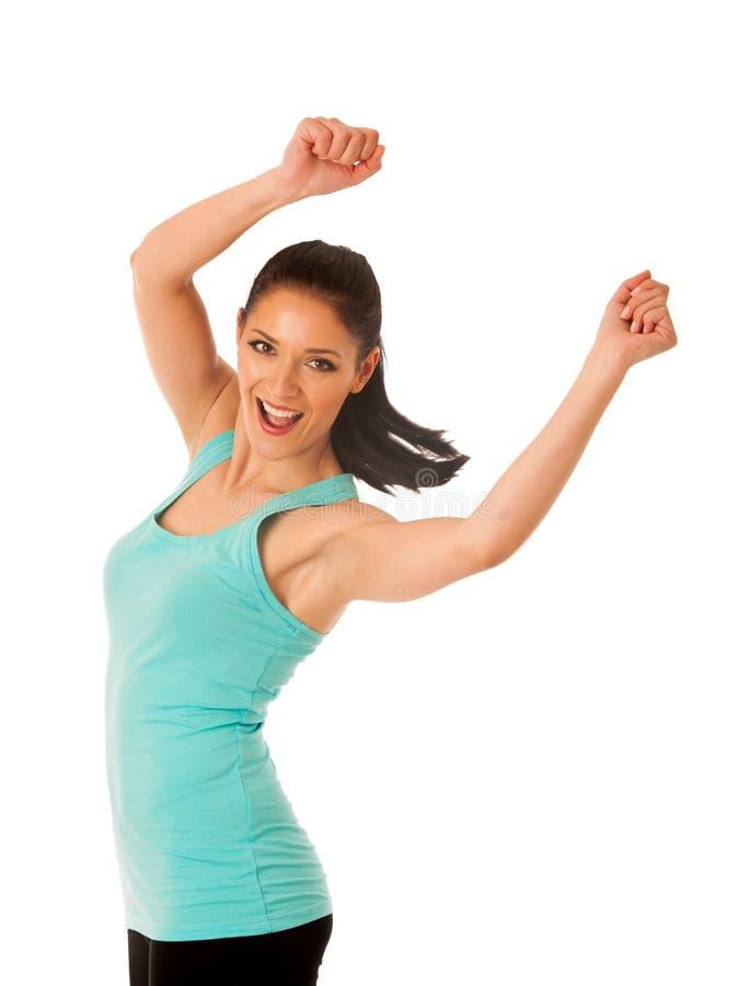 Ajuste feliz e dança magro e salto da mulher isolados sobre o branco foto de stock royalty free