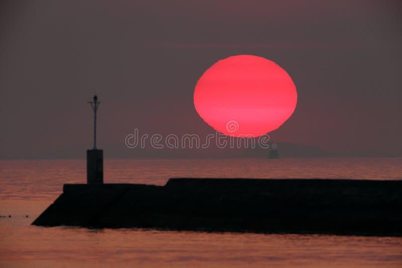 Ajuste grande do sol fotografia de stock