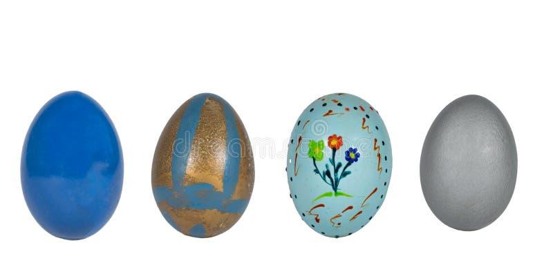 Ajuste, põe, um panorama de quatro ovos da páscoa originais isolados no branco fotografia de stock royalty free