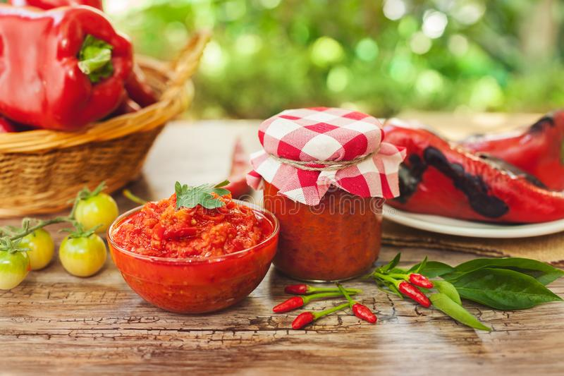 Ajvar in bowl and glass jar royalty free stock photo